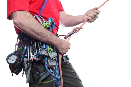 mountaineer with climbing equipment on white background photo