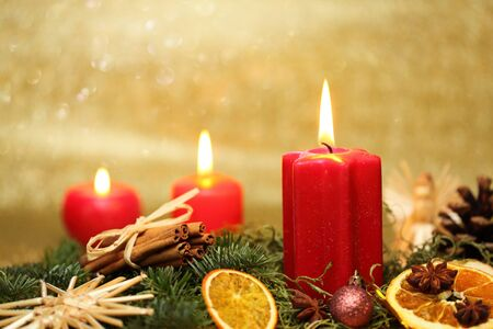 christmas spray with candle light and decoration photo