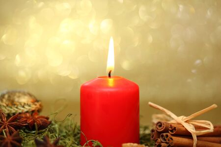 christmas spray with candle light and golden background Stock Photo - 16589699
