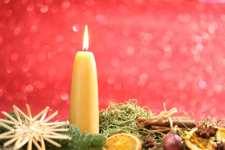 yellow candle light decoration for christmas and advent photo