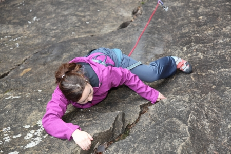 a  girl is free climbing a rock Stock Photo - 17187448