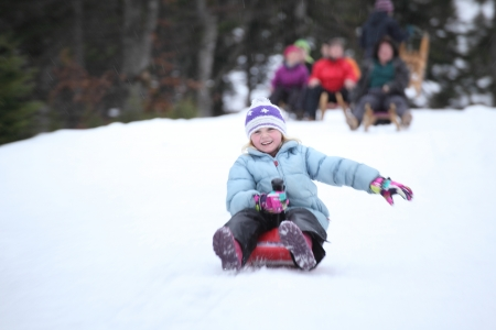 a young girl is sledging in snow  photo