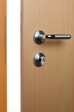 an open door with key and door knob photo