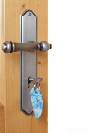 locking up: Locking up or unlocking door with key Stock Photo