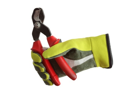 flat nose: a glove is holding a red cutter, white background Stock Photo