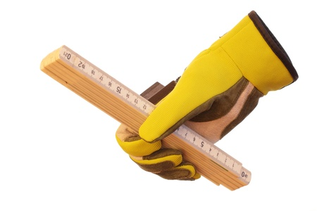 wooden metre: measure rule in hand with glove and white background