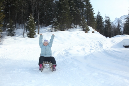 girl have fun with sledge in winter photo