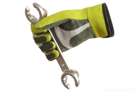 a colored glove with wrench in hand photo