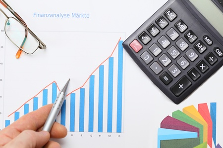 market analysis with office objects and diagram photo