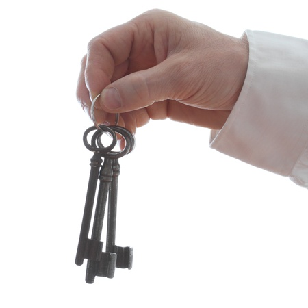 hand is holding a key ring with white background Stock Photo - 18437376