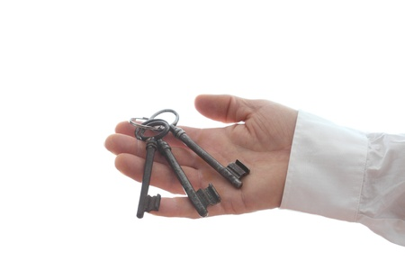 hand is holding a key ring with white background Stock Photo - 18437385