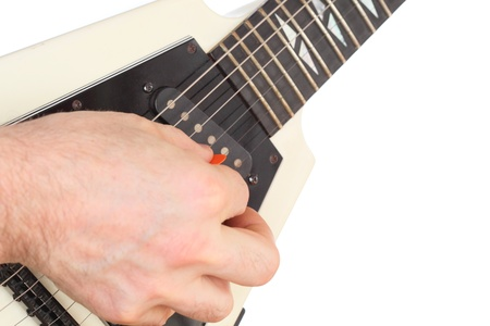 hand is picking with an electric guitar photo