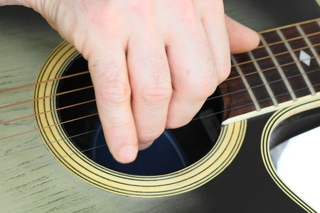 hand is playing with a western guitar Stock Photo - 18522318