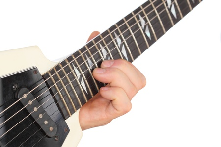 hand is playing with an electric guitar photo