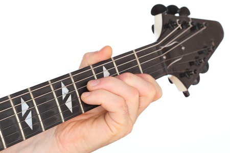 hand and fingers are playing with an electric guitar photo