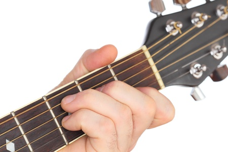 hand is playing with a western guitar Stock Photo - 18522320