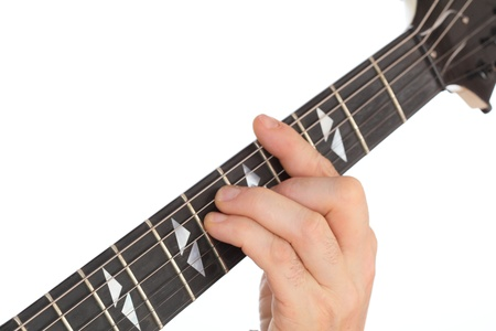 a hand is playing on a guitar fretboard photo