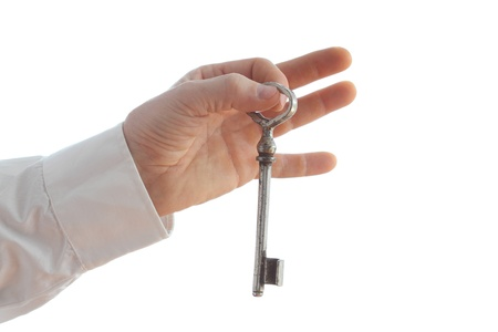 a hand is holding one old  key Stock Photo - 18764454