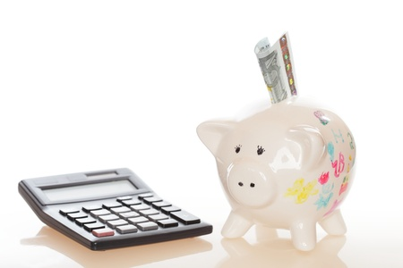 piggy bank with banknote money and calculator photo