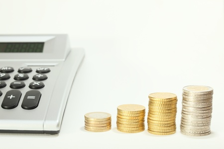 cash calculating with calculator and money coins on desk photo