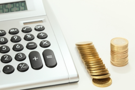 some money coins on desk with calculator photo