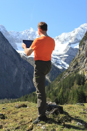 man and mobile pad computer in nature photo