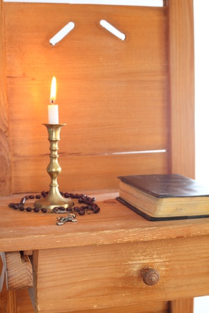 religious things with book cross and candle photo