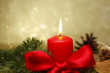 stillife: red candle with bow, christmas decoration stillife