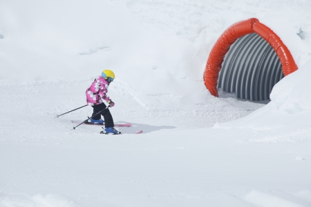 tunel: a happy girl is skiing in snow park Stock Photo