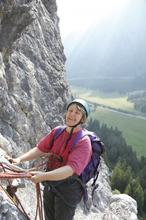 smiling woman is climbing in the austrian alps Stock Photo - 21140719