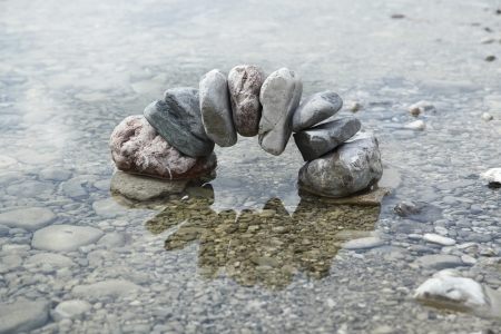 natural stone bow reflected in the water