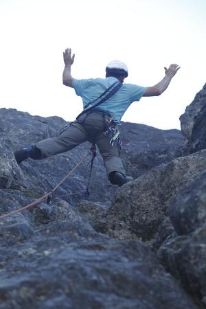a man is climbing in austrian rocks photo