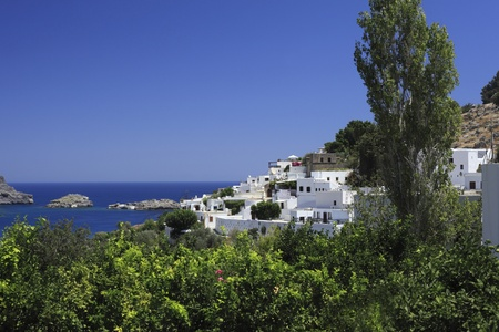 greek city with white houses and blue sky photo