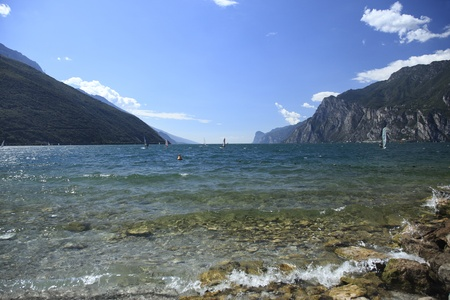 view to blue lake garda with some surfer photo