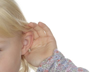 a blond young girl is hearing details photo