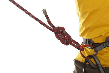 sport climber with yellow shirt and rope knot photo