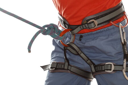save knot on belt of sport climber