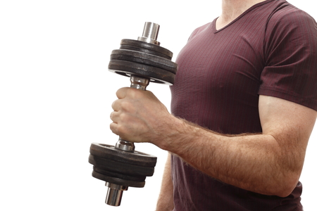 muscle training with dumbbell on white background photo
