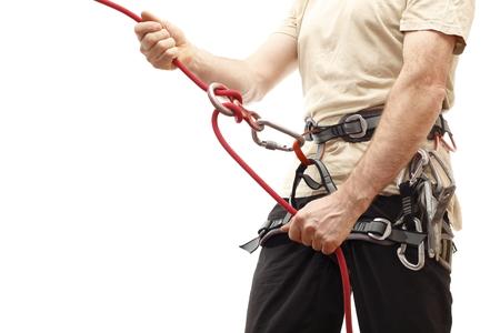 Kletterer mit Ocker Shirt und Seil auf weißem Hintergrund Standard-Bild - 26141590