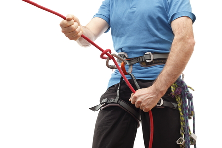 climber with blue shirt and equipment on white background photo