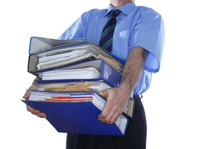 business man is holding many document folders