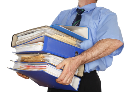 business man is carrying many different folders Stock Photo