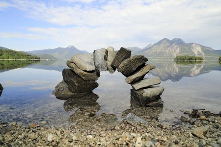 symbolic natural stone bridge in bavarian lake