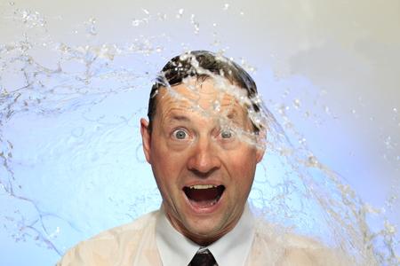 bisiness: business man got a cold water shower