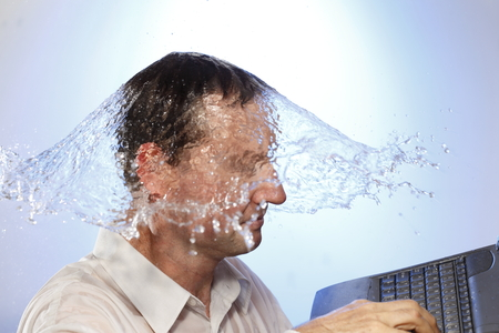 bisiness: business man  with notebook and water splash Stock Photo