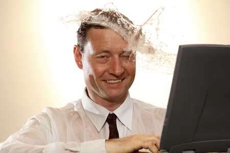bisiness: business man looks to notebook and water splash Stock Photo