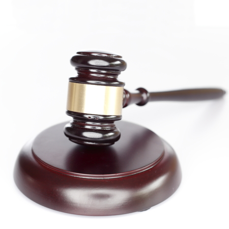 ruling: Close up of a wooden judge or auctioneers gavel with a brass Stock Photo