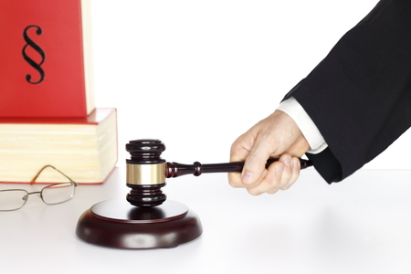 symbolic judgement with gavel in hand and books  photo