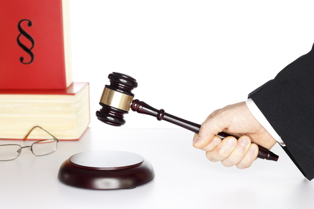wooden gavel and bookon a table, justice symbol photo