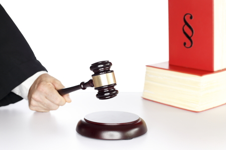 man with wooden gavel and book, justice symbol photo